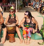 21333095 arambol goa february 5 2013 unidentified people in carnival costumes sit talk play the djembe drum a stock photo